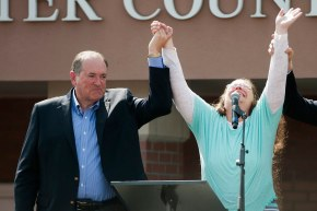 GRAYSON, KY - SEPTEMBER 8:  Rowan County Clerk of Courts Kim Davis holds her hands in the air with her attorney Mat Staver (R) and Republican presidential candidate Mike Huckabee in front of the Carter County Detention Center on September 8, 2015 in Grayson, Kentucky. Davis was ordered to jail last week for contempt of court after refusing a court order to issue marriage licenses to same-sex couples. (Photo by Ty Wright/Getty Images)