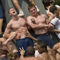 A Shitload of Pictures Of Half-Naked Greased Up Military Men Climbing A Stone Monument